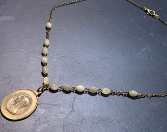 Mother-of-pearl rosary necklace and Lourdes Vintage medal.