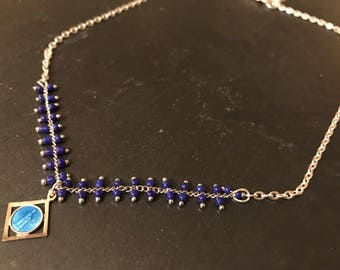 Blue seed beads and medal vintage beaded necklace