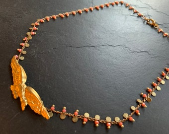 Vintage Sparrowhawk necklace on coral beaded mesh