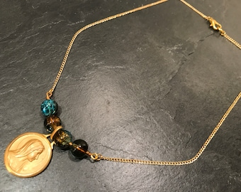 Gold necklace, glass beads and vintage medal