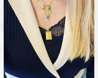 Trio of vintage Virgin medals and Matiasma on gold rectangle chain