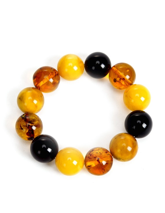 Baltic Multicolor Amber. Weight 43 g. Dimensions 18.5-19 mm.