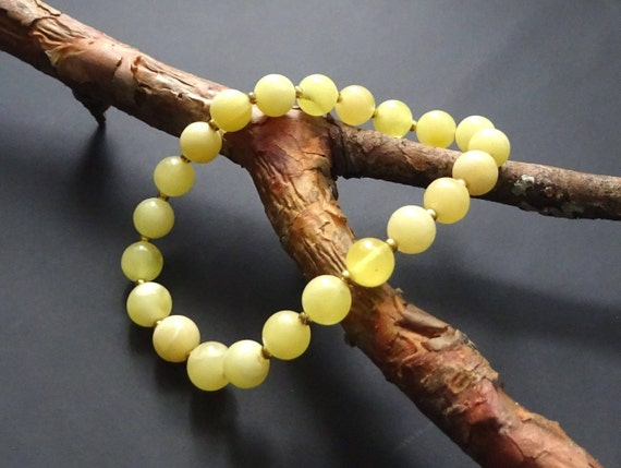 Baltic Amber Beautiful Bracelet. Egg Yolk Color. Weight ~ 4.50 g. 天然琥珀 #ET0095