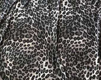 a3964ad64e0 Gray Stretch Rayon Spandex Jersey Animal Print Fabric By The Yard 60