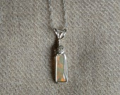 1.1 carat Opal Wire Wrapped Sterling Silver Pendant