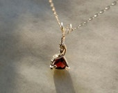 1.56 carat Faceted Garnet Wire Wrapped Sterling Silver Pendant