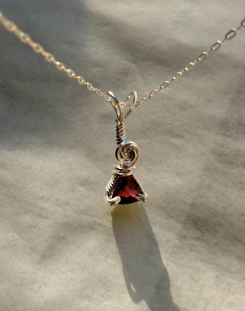 1.56 carat Faceted Garnet Wire Wrapped Sterling Silver Pendant image 0