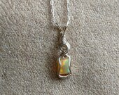 0.8 carat Opal Wire Wrapped Sterling Silver Pendant