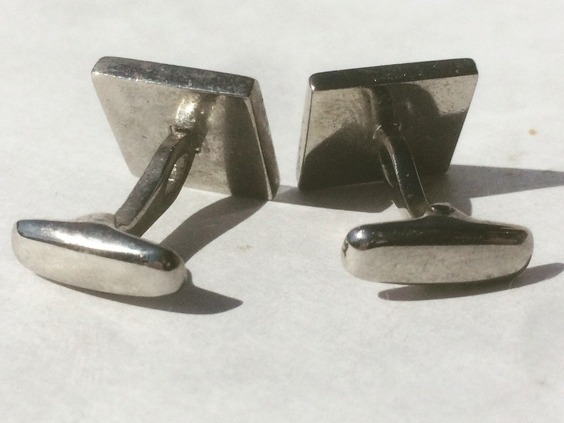 pair of mid century cuff links with three shades of blue