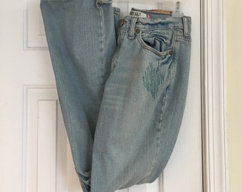 dc1394f0 Vintage Levi's 515 boot cut blue denim jeans enhanced with stitching, etc.  true vintage showing lots of wear. Sz 4 M Slim fit 28 waist