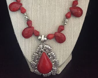 Bright red beaded necklace set with oxidized pendant and matching earrings