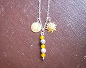 Charm Necklace with Fire Agate Beads, Sun and Moon Charms