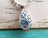 Cage Locket Blue Cat's Eye Glass