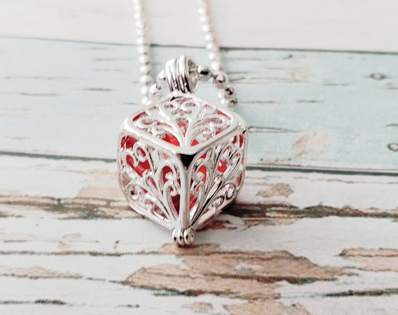Silver Cage Locket Necklace. Red Millefiori Bead in Cage. image 0