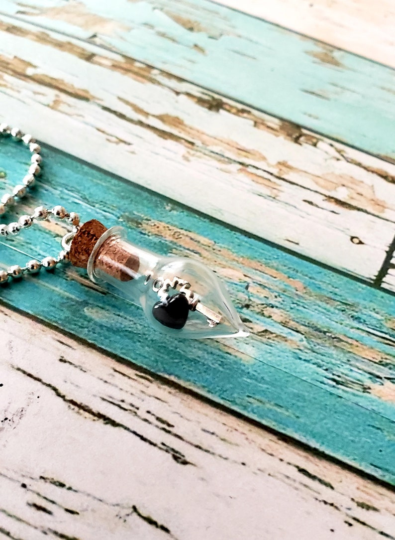 Glass Vial with small Hematite Heart and Silver Alloy Key image 0