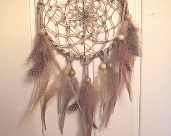 Dream catcher with flower of life. Natural feathers and leather cord wood beads