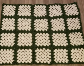 """This granny square baby blanket is about 30"""" × 26""""."""
