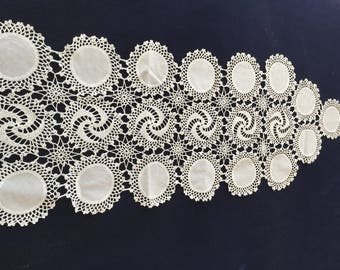 Decorative White Lace Cover for a Dining Room Table