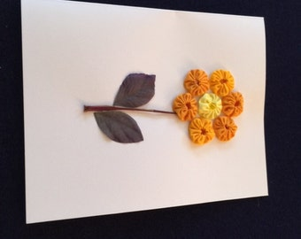 Greeting Card with an Orange Flower Design