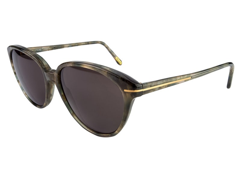 f8076ad943c Versace sunglasses made in Italy in the 80s. Vintage cat eye