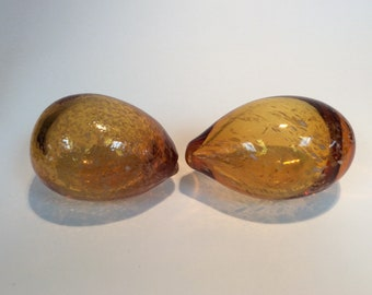 Pair Blenko Glass hand blown egg paperweights amber with white speckles.