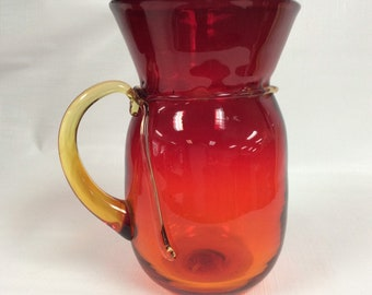 "Blenko Glass 7831 pitcher in tangerine, ""hand tied series"" Don Shepherd design."