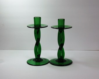 Pair of emerald green hand blown glass candle holders with twisted stem