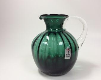 Pilgrim Glass dark green pitcher with crystal handle.