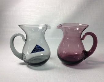 Pair of Morgantown mini pitchers. One amethyst, one smoke gray.