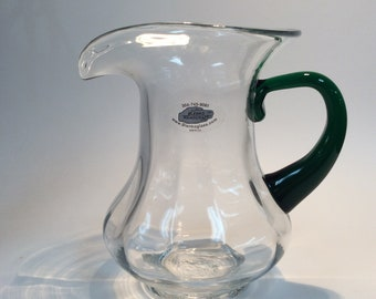 Blenko Glass non catalog hand blown pitcher, crystal optic with emerald green handle.
