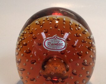 Rainbow Glass Company amber controlled air bubble paperweight with sticker