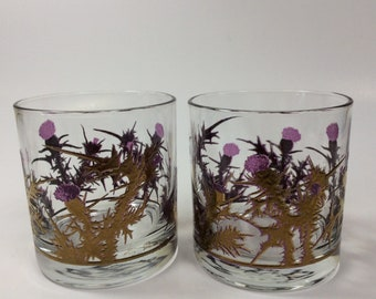 Two West Virginia Glass Gregory Duncan purple thistle glasses trimmed in gold.
