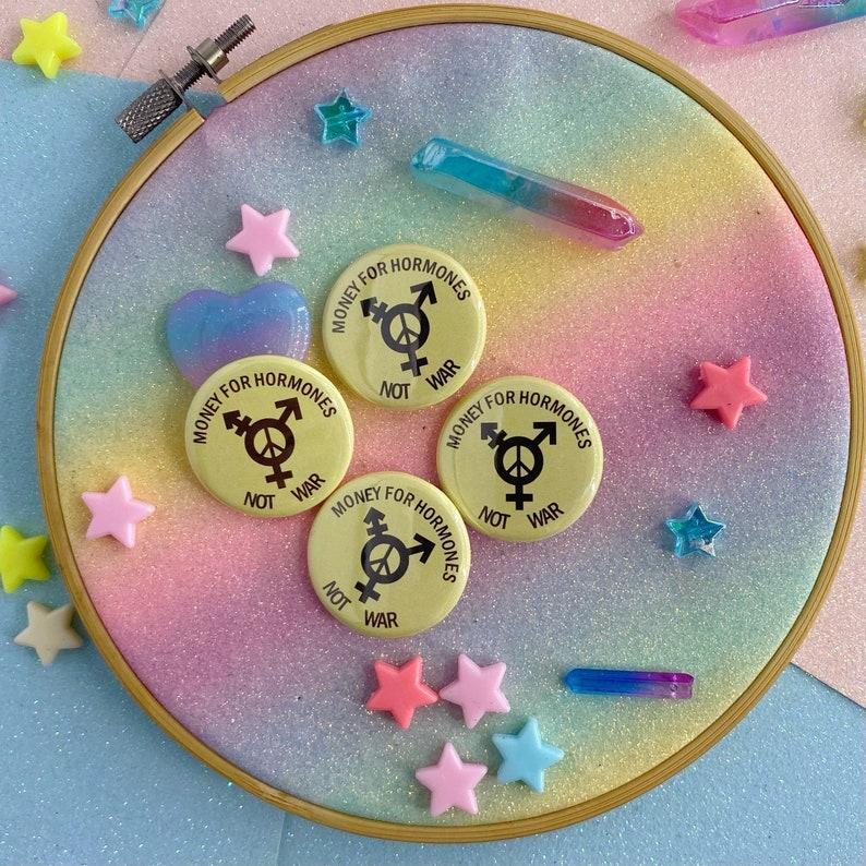 Money For Hormones Not War Button Badge