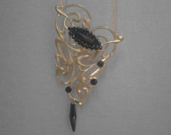 Gold plated Art Nouveau necklace with scrollwork and Jet faceted stones