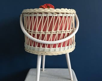 Sewing basket on legs, braided and finished with years 70 fabric.