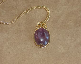 341 Three wire gold small amethyst cabochon with double loop