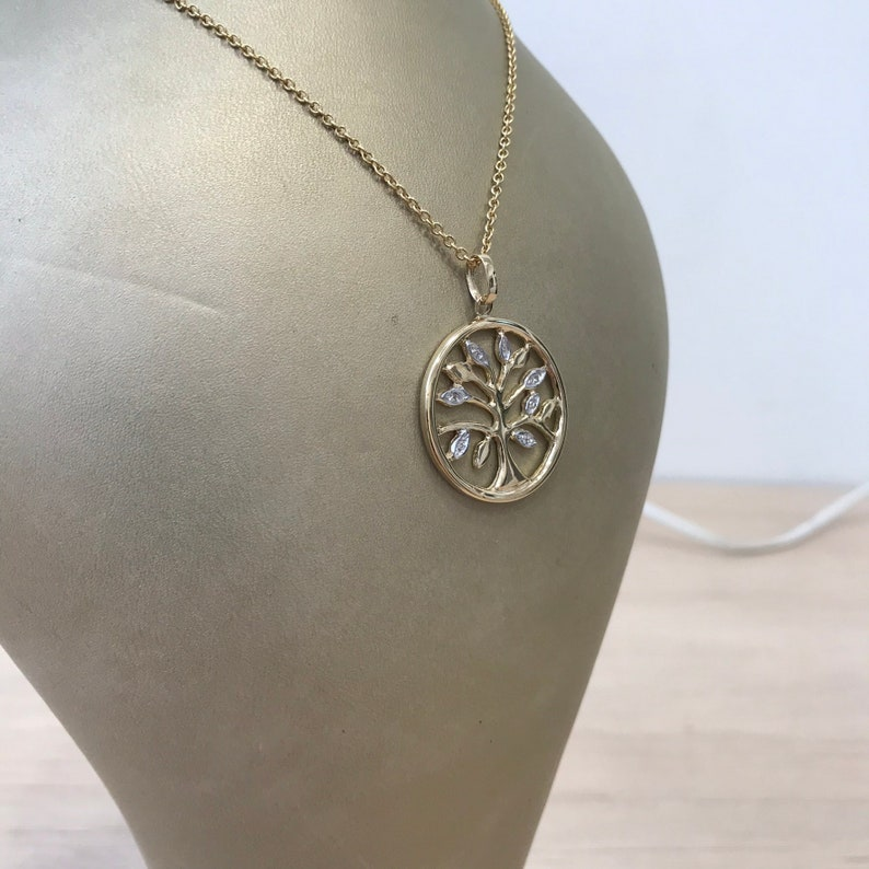 Yellow 9k solid gold artisan Tree of Life necklace with diamond accents on solid gold rolo chain