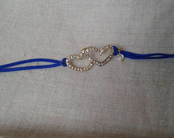 white blue bracelet and two hearts