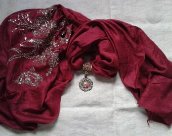 red scarf and a floral print jewelry