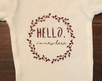 "Baby One Piece -- ""Hello, I'm New Here"" -- Size 0-3 Months"