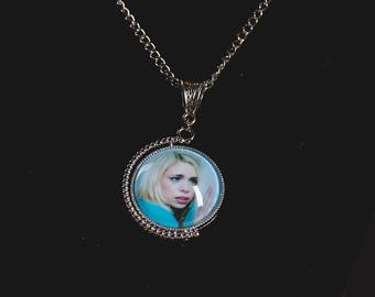 Doctor Who inspired two-sided/spinning 10th Doctor and Rose Tyler image pendant necklace.