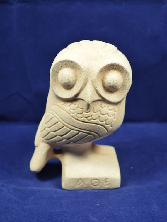 Owl wide eyes sculpture statue
