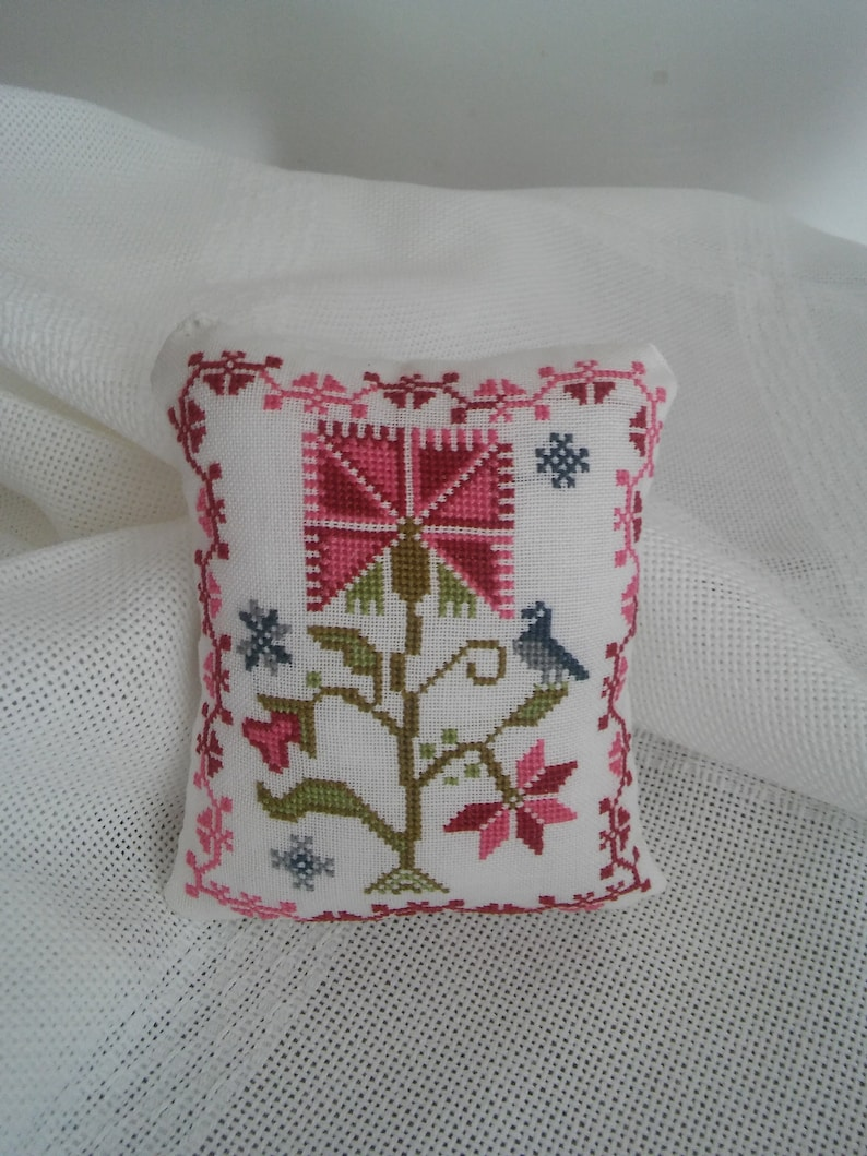 home decor exclusive gift Beautiful  handmade cross stitched pincushion with floral motif