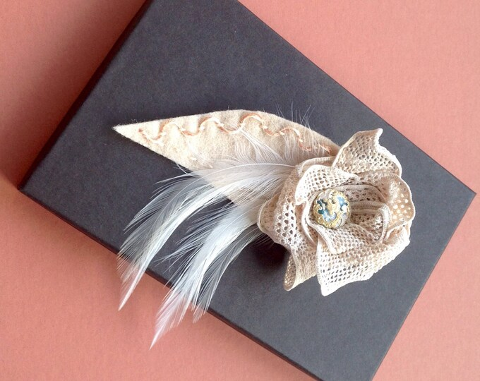 Antique lace and feather corsage, hand embroidered with gold /enamel button.