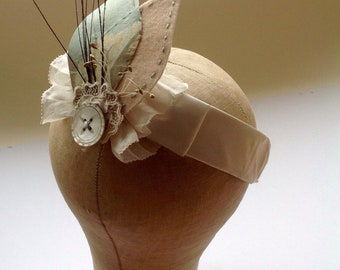 Silk and lace corsage with hand embroidery, feather, vintage stamens and mother-of-pearl button.