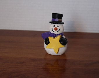 bisque snowman with star hand painted