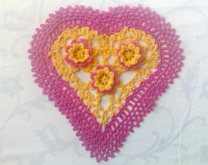 Featured listing image: Pink crocheted heart cover with yellow pink 3d crochet flowers