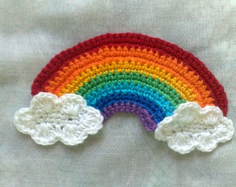 Rainbow and clouds crocheted applications in white and in the rainbow colors Violet, indigo, light blue, green, yellow, orange and red