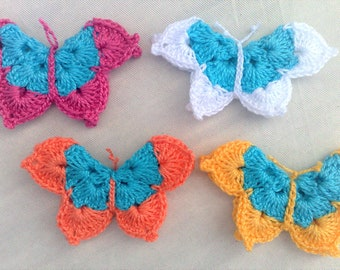4 crocheted Butterfly Applications Three-dimensional in a colourful mix for decorative embellishments for decorating baby clothes