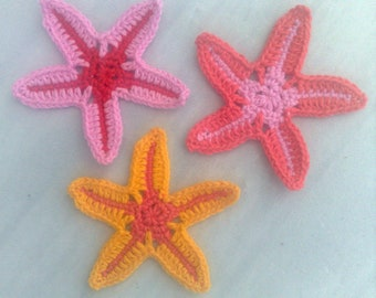 crocheted colorful starfish for beautifying bags, hats and clothes